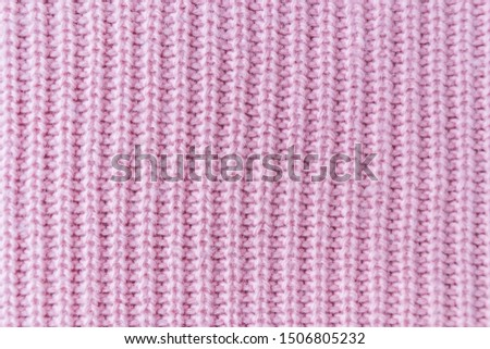 The closeup texture of pink cashmere sweater background. Macro shot of knitted fabric from Lana Wool threads. #1506805232