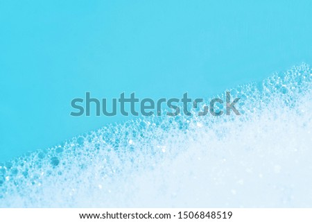 Backgrounds of blue wet soap bubbles on blue background. Laundry detergent, suds textured pattern. White soap suds macro view. Abstract textured effect of blue soap foam close-up. divided frame #1506848519