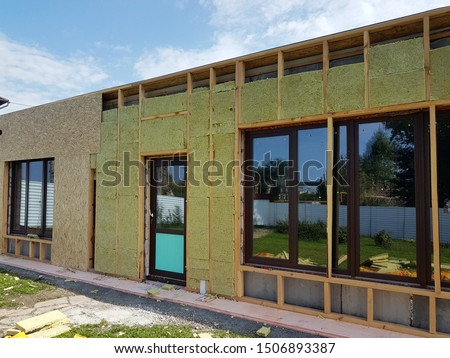 Construction of external wall thermal insulation with rock wool. Exterior passive house wall heat insulation with mineral wool. Insulation the facade of commercial building. #1506893387