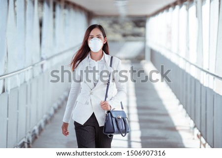 Asian woman are going to work.she wears N95 mask.prevent PM2.5 dust and smog #1506907316