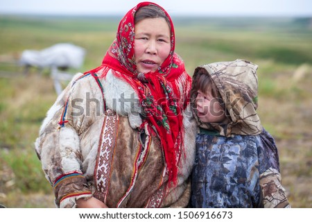 The extreme north, Yamal, the past of Nenets people, the dwelling of the peoples of the north, a family photo near the yurt in the tundra #1506916673