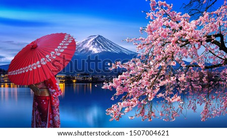 Asian woman wearing japanese traditional kimono at Fuji mountain and cherry blossom, Kawaguchiko lake in Japan. #1507004621