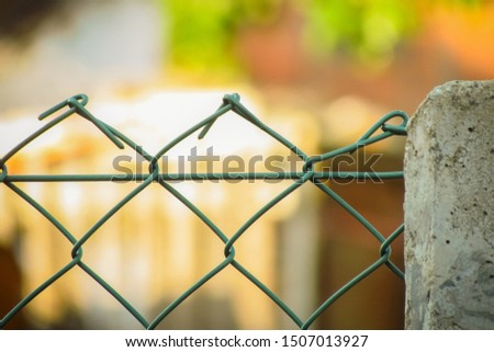 Plastic green wire fence on nature background #1507013927