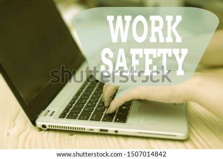 Conceptual hand writing showing Work Safety. Business photo showcasing Policies and control in place according to government standard woman with laptop smartphone and office supplies technology. #1507014842