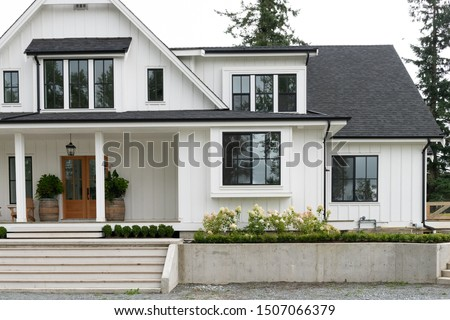 Front door and entrance to a luxury North American farmhouse-style villa #1507066379