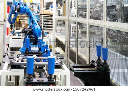 The robot 's injecting sealing to glass in Production line for manufacturing of the car body in the car factory. Car factory. . Body factory. New body factory. Car body on line. #1507242461