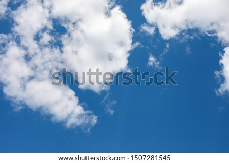 bright blue sky half covered by white clouds. Pure, clear cumulus cloud in sky on sunny day. Earth atmosphere. Royalty-Free Stock Photo #1507281545