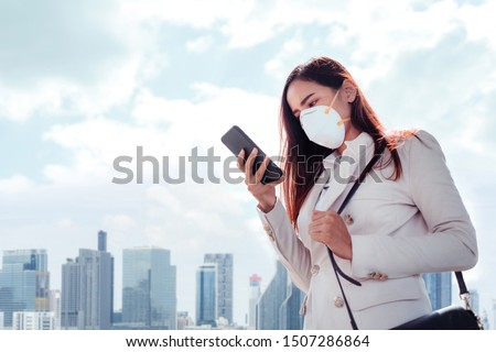 Asian woman are going to work.she wears N95 mask.prevent PM2.5 dust and smog #1507286864