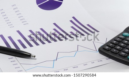 Bar Chart, Line Chart In dark slate blue color with pen and Calculator  #1507290584
