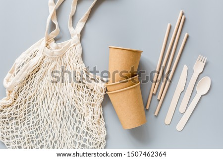 eco natural paper cups, straws, bag flat lay on gray background. sustainable lifestyle concept. zero waste, plastic free items. stop plastic pollution. Top view, overhead, template, Mockup. #1507462364