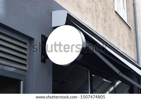 Blank modern metal signage hanging in shopping center for advertising #1507474805