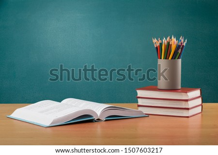 School books ,color pencil ,pen on desk,can creative infographics blackboard inside , the education concept, and gray color background #1507603217