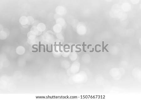 Abstract White Bokeh with soft blurred background nature blurry light party in vintage style warm pastel shimmering and faded cool colorful defocused circular. Shiny copy space for holiday card.