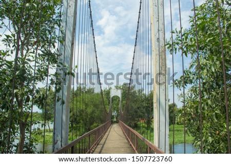 Ancient suspension bridge,Suspension bridge and blue sky. #1507723760