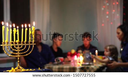 Happy Jewish Family Celebrates Hanukkah. Festival of Lights. Israel people. The Hanukkah menorah