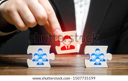 A businessman appoints a leader to the head of the team. Creation of an effective teams of specialists for the implementation of a new project. HR recruiting. Management appointment. nepotism #1507735199