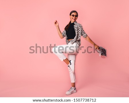 Full Length Portrait of Trendy Hipster Girl Standing at the pink Wall Background. Urban Fashion Concept. Copy Space. #1507738712