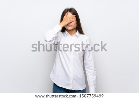 Young woman over isolated white background covering eyes by hands #1507759499