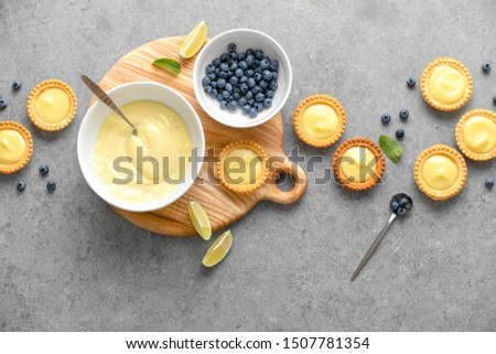 Tartlets with custard and blueberry, top down view, blank space for a text #1507781354