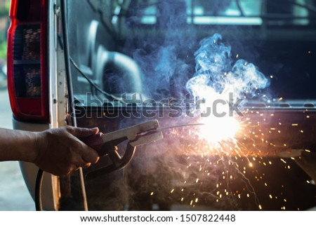 Welding the car body after the accident #1507822448
