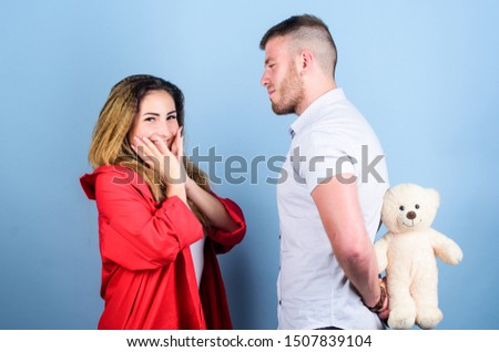 Surprising her. Handsome man and pretty girl in love. Man and woman couple in love. Romantic surprise. Valentines day holiday. Surprise for sweetheart. Soft toy teddy bear gift. Surprise gift concept. #1507839104