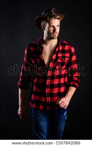 Masculine ideal. Masculinity and brutality concept. Cowboy life came to be highly romanticized. Adopt cowboy mannerisms as a fashion pose. Man unshaven cowboy black background. Western life. #1507842086