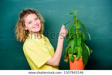 Botany is about plants flowers and herbs. Take good care plants. Girl hold plant in pot. Plants that sure stress relief home and provide you with sanctuary of peace and tranquility. Florist concept. #1507842146
