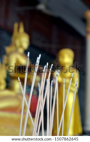 In Buddhism, incense is burned to pay homage to idols of the Blessed Buddha. #1507862645