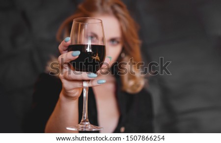Beautiful woman with glass red wine - selective focus. #1507866254