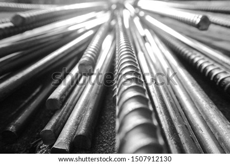 close up steel bar or steel reinforcement bar in the construction site with sunbeam at the morning, steel rods bars can use for reinforce concrete.  #1507912130