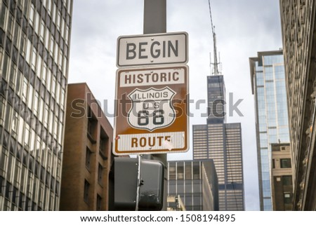 A simple sign marks the starting point of historic Route 66, from Chicago to Los Angeles #1508194895