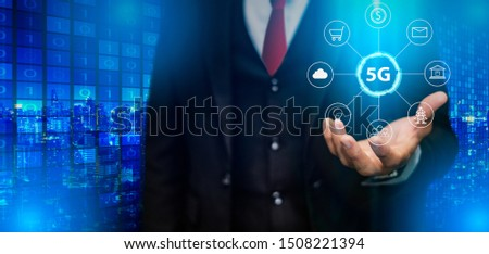 Businessman hand holding 5G network digital hologram and internet of things on city background.5G network wireless systems.IoT(Internet of Things), ICT,communication network concept. #1508221394