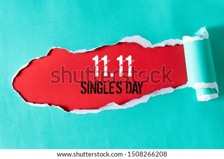 Online shopping of China, 11.11 single's day sale concept. Top view of green pastel torn paper and the text 11.11 single's day sale on a red background. Royalty-Free Stock Photo #1508266208