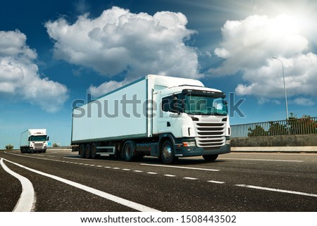 White truck is on highway - business, commercial, cargo transportation concept, clear and blank space on the side view #1508443502