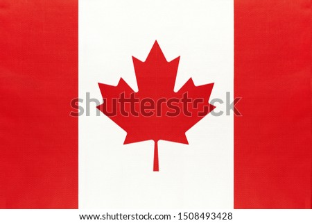 Canada national fabric flag, textile background. Symbol of international world north America country. State Canadian official sign.