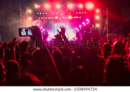 People taking photographs with smart phone during a public music concert #1508494724