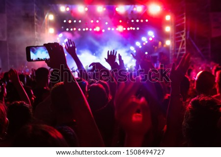 People taking photographs with smart phone during a public music concert #1508494727