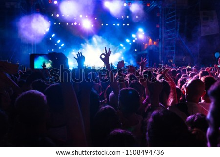 People taking photographs with smart phone during a public music concert #1508494736