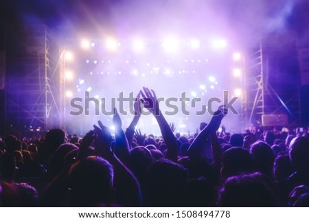 People taking photographs with smart phone during a public music concert #1508494778