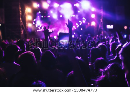 People taking photographs with smart phone during a public music concert #1508494790