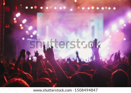 People taking photographs with smart phone during a public music concert #1508494847
