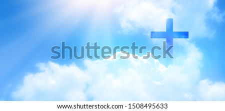 Christian cross appeared bright in the sky with soft fluffy clouds, white, beautiful colors. With the light shining as hope, love and freedom in the sky background