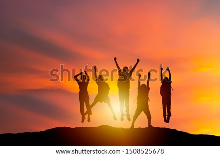 successful human and fighting spirit, Silhouette group young, people are delighted by show of hands higher. succeed. Business, successful, achievement, teamwork and goal concept. #1508525678
