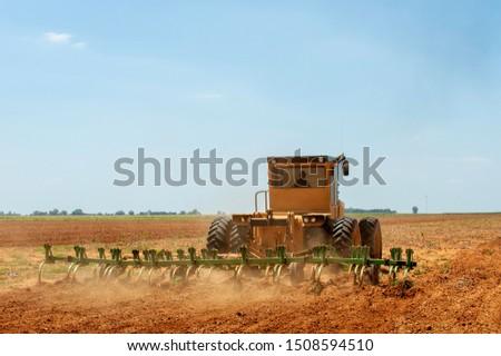 Hot heat summer sun ploughing fields in Kwazulu Natal South Africa, dusty movement blur, tractors, machinery #1508594510
