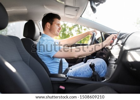 transport, vehicle and people concept - man or driver driving car and using gps navigator #1508609210