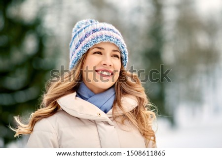 people, season and leisure concept - portrait of happy smiling woman outdoors in winter #1508611865