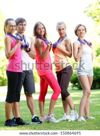 Caucasian young team with espanders in a park #150864695