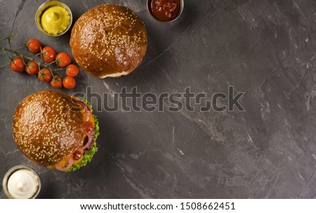 High angle beef burgers with cherry tomatoes #1508662451
