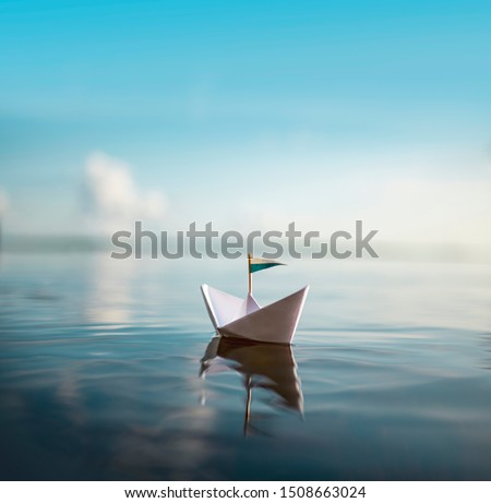 Small Paper Ship floating on Water #1508663024