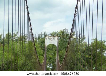 Ancient suspension bridge,Suspension bridge and blue sky. #1508696930